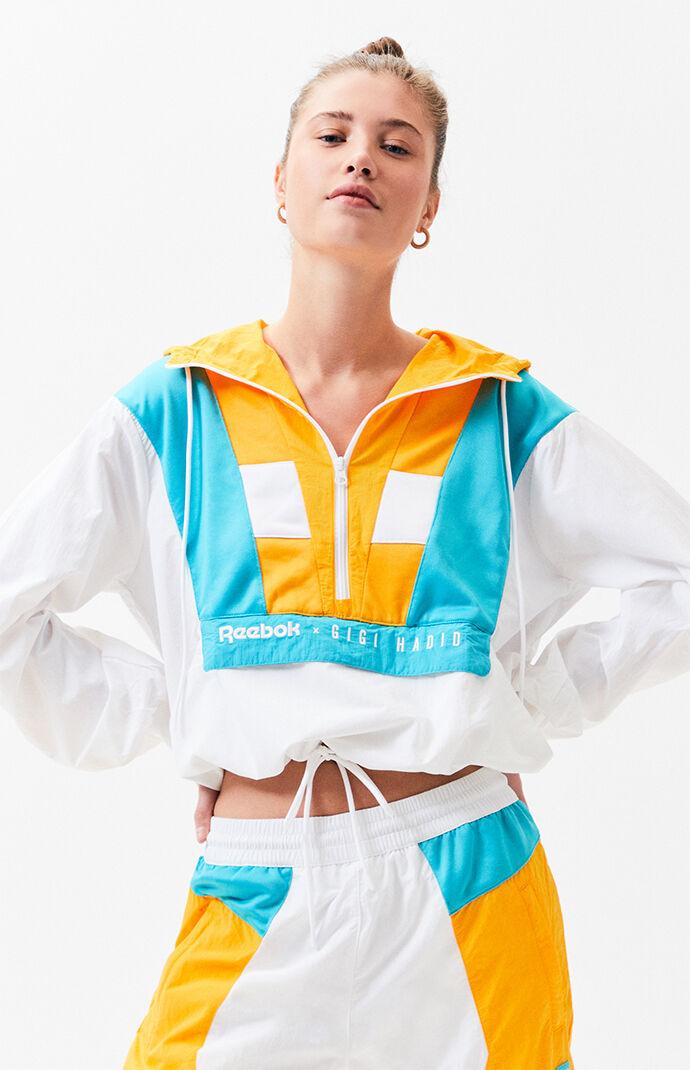 2480a8a5f45 Reebok x Gigi Hadid White and Orange Half Zip Hoodie