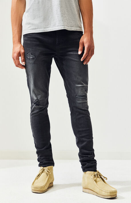 85a3115c Black Stitch & Repair Stacked Skinny Jeans