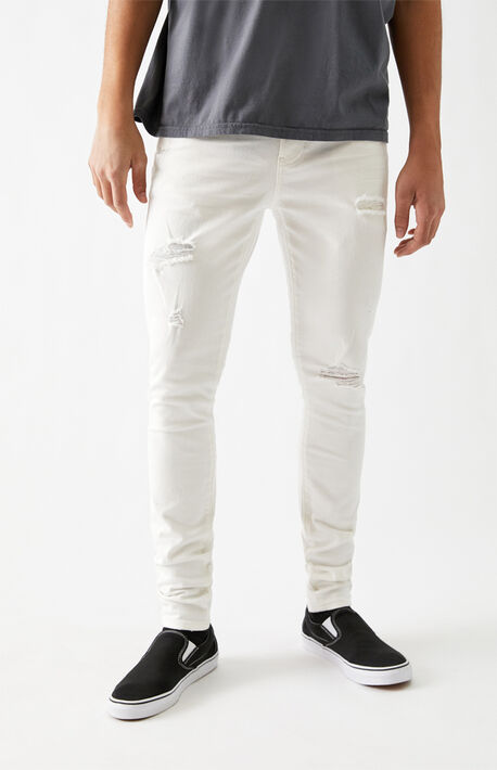 White Ripped Stacked Skinny Jeans