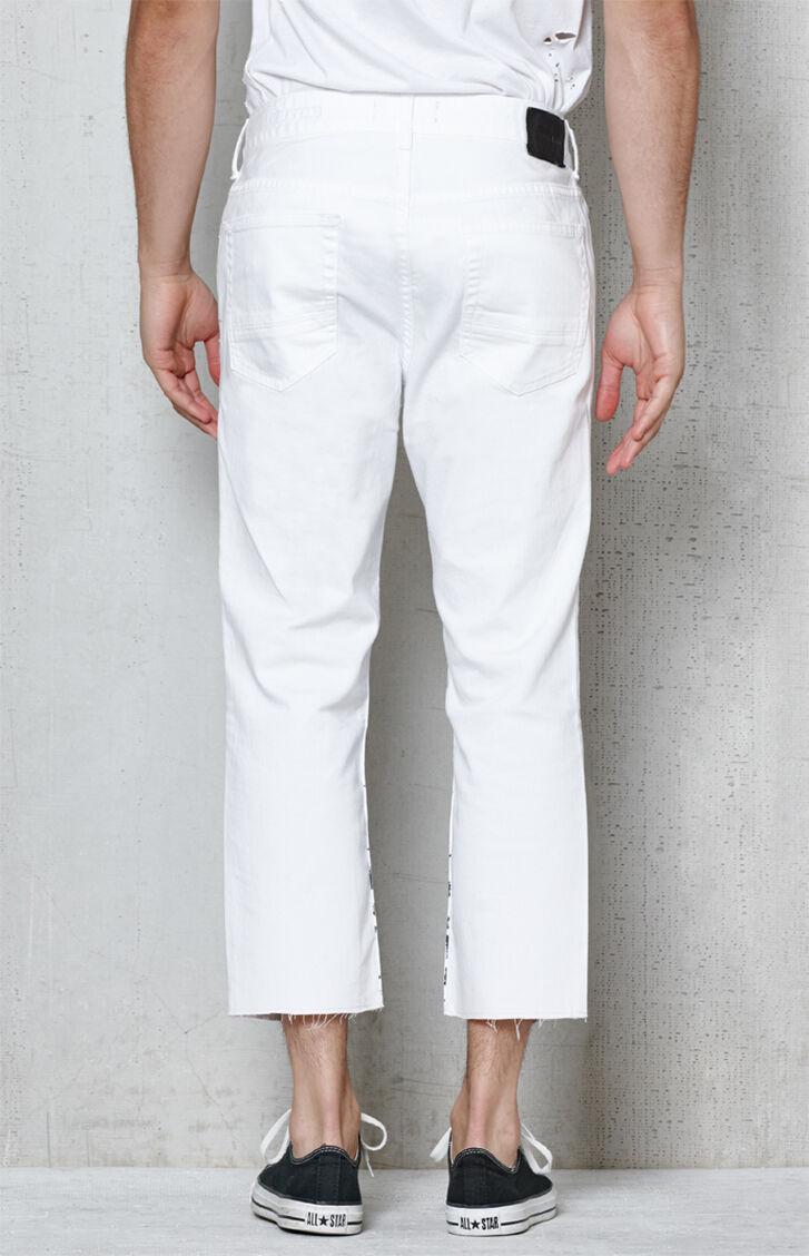 Available In White Button Closure Zip Fly Knee Blowout 5-Pocket Slim Fit 98% Cotton 2% Spandex.